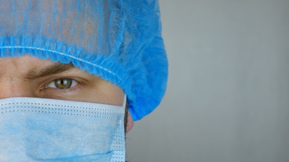 A person wearing a mask and other health-related gear