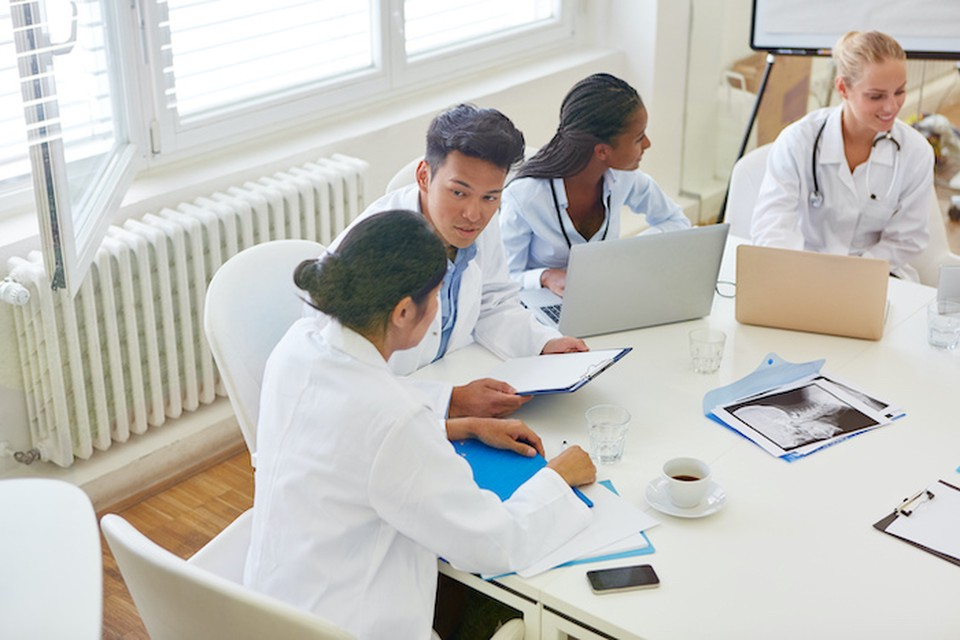 Students in medical school learning together in workshop